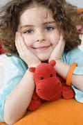Portrait of a little girl with a cuddly toy Stock Photos