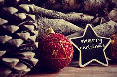 text merry christmas in a star-shaped blackboard - stock photo