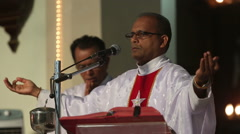 priest on the podium welcomes parishioners - stock footage