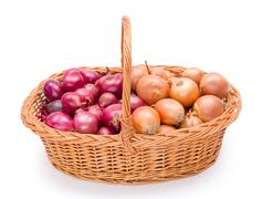 Full basket with onions crop Stock Photos