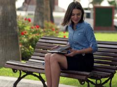 Young  businesswoman finishing her work on laptop, relaxing on the  bench NTSC Stock Footage