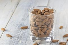 Almonds in a glass Stock Photos
