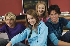 2 teenage boys and 2 teenage girls smiling for camera - stock photo