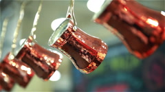 Many copper Cezve coffee hang in the city cafe. Stock Footage