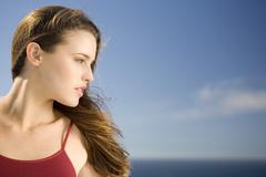 Portrait of a young woman, profil, outdoors - stock photo