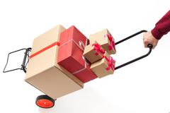 Hand truck with present boxes Kuvituskuvat