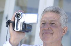 Man using camcorder Stock Photos