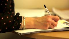 Tracking Shot Past Woman Taking Notes 2 - stock footage