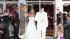 Bride and Groom Leaving Church Stock Footage