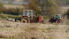 Autumn Plowing the Fields with a Tractor 4k Video 6 Stock Footage
