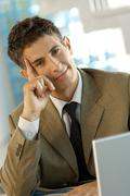 Stock Photo of Mature adult businessman sitting in office, portrait