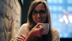 Portrait of cute, beautiful woman sitting with tea in cafe HD Stock Footage