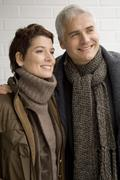 Close-up of a mature man and a mid adult woman standing Stock Photos