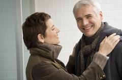 Mature man and a mid adult woman smiling Stock Photos