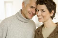 Portrait of a mature man and a mid adult woman romancing Stock Photos