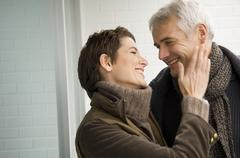 Close-up of a mid adult woman and a mature man romancing Stock Photos