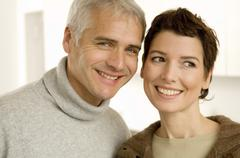 Stock Photo of Close-up of a mature man and a mid adult woman smiling