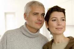 Close-up of a mature man and a mid adult woman looking away Stock Photos