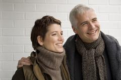 Close-up of a mature man arm around a mid adult woman and smiling Stock Photos