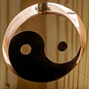 Yin and yang on a wooden stand Stock Photos