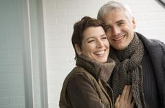 Portrait of a mature man and a mid adult woman smiling Stock Photos