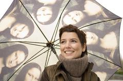 Close-up of a mid adult woman holding an umbrella Kuvituskuvat