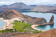 volcano island st. bartolomé, galapagos, ecuador with pinnacle-rock - stock photo