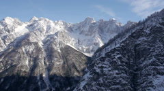 Aerial - Mountain wall hiding Alps behind Stock Footage