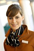 Stock Photo of Portrait of a female airline check-in attendant smiling