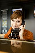 Stock Photo of Portrait of an airline check-in attendant talking on the telephone