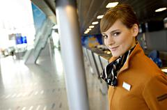 Portrait of a female airline check-in attendant smiling - stock photo