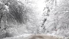Driving in the snowy winter road Stock Footage