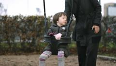 Small Girl on Swing with Mather  in PArk Stock Footage