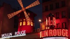Le Moulin Rouge, Boulevard de Clichy, Paris, France, Europe Stock Footage