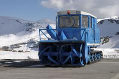 Blue snow blower in the Alpes Stock Photos