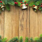 decorated christmas tree border on wood paneling - stock photo