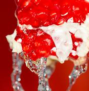 Ripe red pomegranate in water Stock Photos