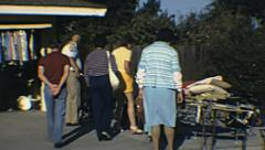 USA 1982: people at a garage sale Stock Footage