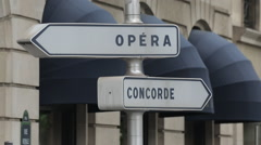 Opera Concorde signs near L'eglisede la Madeleine, Paris, France, Europe Stock Footage