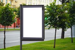 Blank billboard on city street Stock Photos