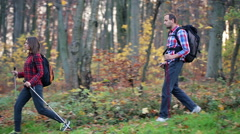 Young couple hiking in autumn forest HD Stock Footage
