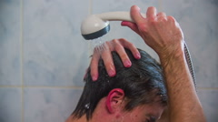 Watering hair under a shower Stock Footage