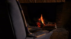 the warmth of the fireplace - stock footage