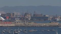 Pan right follow Naples industrial port day crane machine work cruise bay Italia Stock Footage
