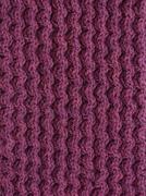 Purple cable knitting stitch Stock Photos