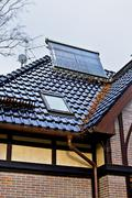 Solar collector on the roof of a house Stock Photos