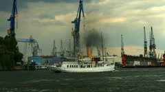 Hamburg harbour ships with rainstorm approaching Stock Footage