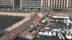 Aerial view Naples cityscape pedestrian walkway commercial port yacht anchoring  Stock Footage