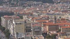 Pan left aerial view Nice panoramic Negresco hotel sea beach traffic street day Stock Footage