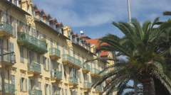 Nice architecture old town sunny day yellow facade palm tree french luxury shore Stock Footage